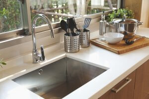 How do I disinfect my kitchen sink
