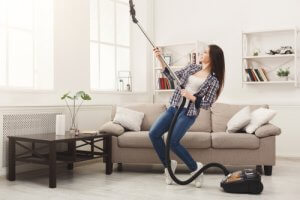 Is it better to dust or vacuum clean first